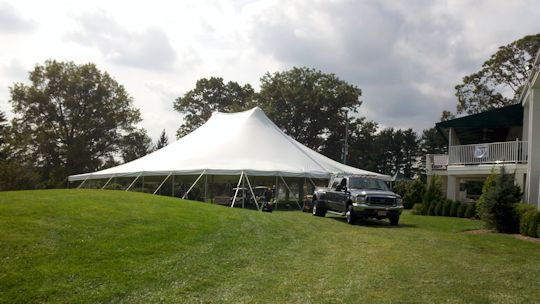 A Party Center 60 x 60 pole tent after install