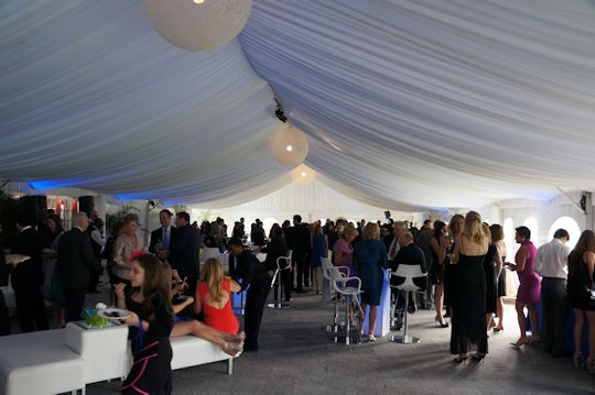 clients enjoying tented event
