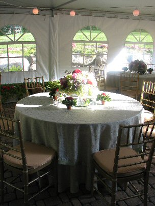 5 foot round table with floral arrangement