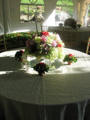 close up of 5 foot round table with floral arrangement