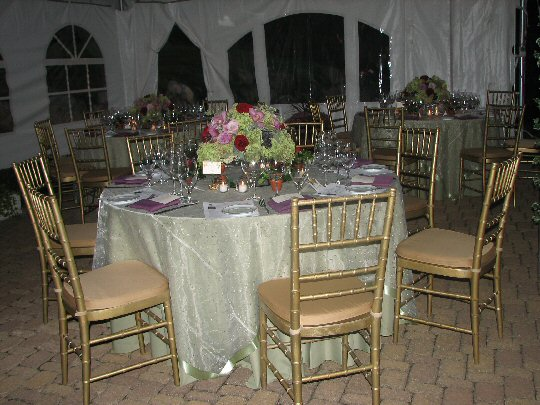 five foot round table with chairs and formal settings