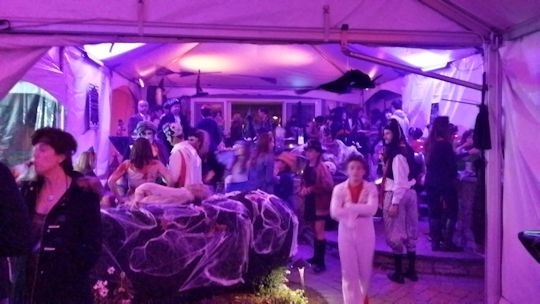 costume party under tent installed on tiered patio