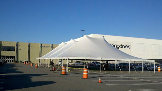 White tentsion tent installed on parking lot